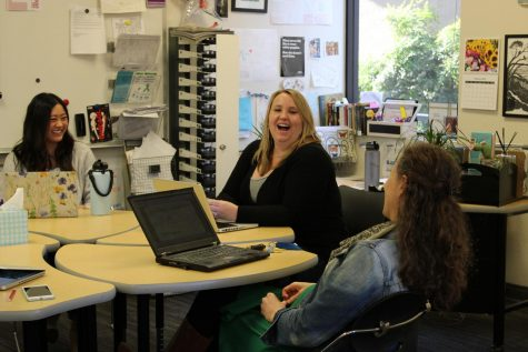 English teachers Kathryn Gong-Guy, Kristin Moore and Claire Ballard discuss possible summer reading options during an English department meeting on Feb. 13.