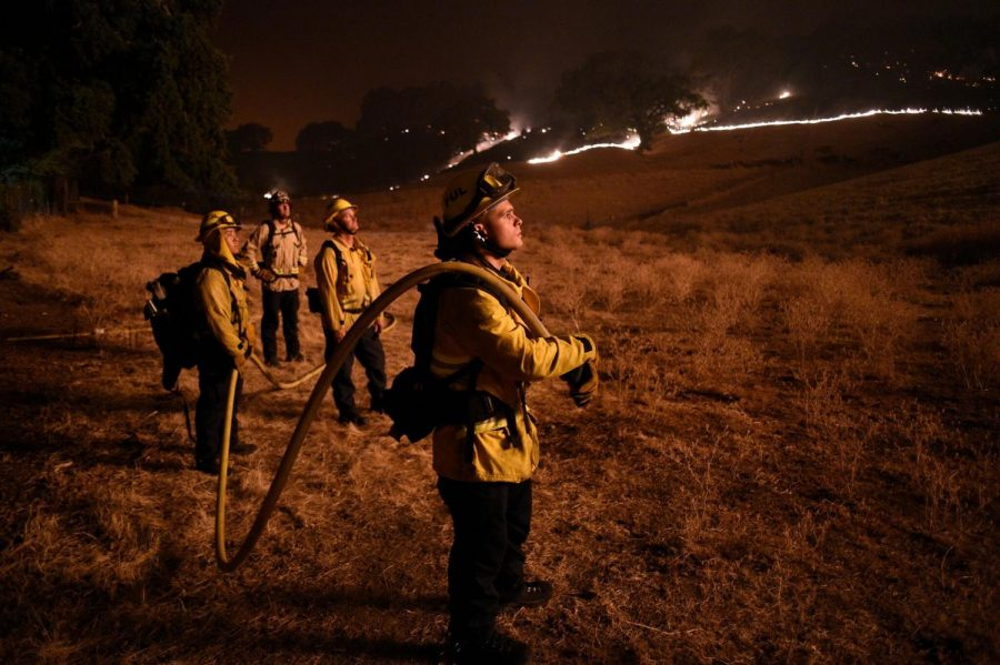 Firefighters battled to get control of the blazes in Napa, Calif., which were caused by lightning strikes.