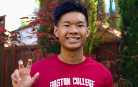 Two weeks after his verbal commitment, Thien wears a Boston College shirt and poses with an eagle claw sign for a photo to inform his friends and family about his verbal commitment.