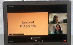 Chelsea Nguyen covers her mouth in surprise as Zuleika Cruz announces that the juniors received last place with 60 points. In the chat, seventh grader Matthew Pham writes
