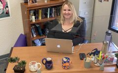 English Department Chair and Professional Development Coordinator Kristin Moore at her desk in Johns Hopkins at UPA, where she teaches her classes.